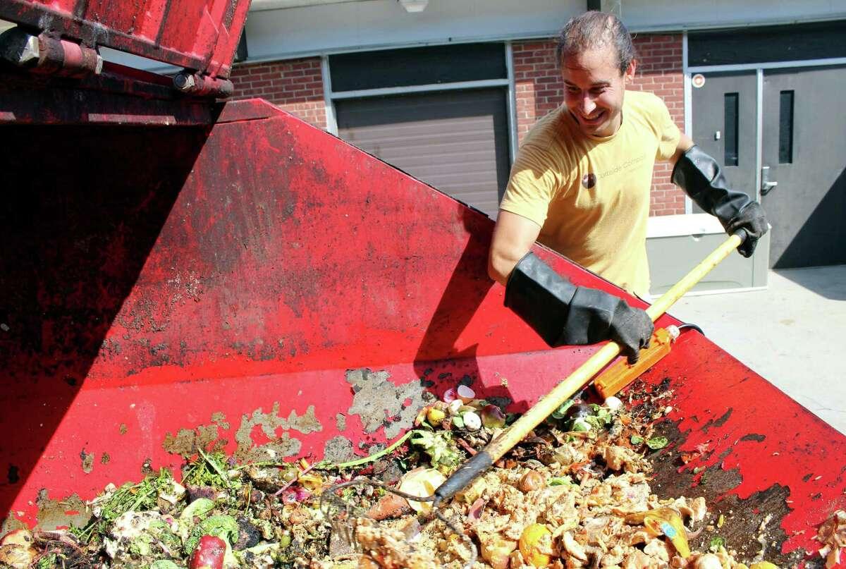 Nick Skeadas, of Curbside Compost in Ridgefield, picks up food scraps from Middlebrook School.