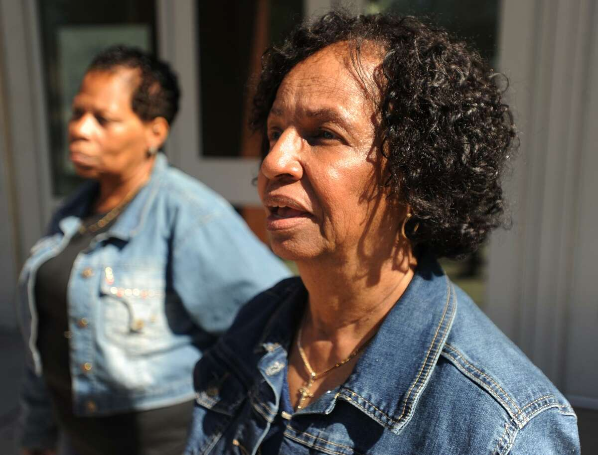 Foster Grandparents Fernanda Woolford, left; and Audrey Fernandes, outside Jettie Tisdale School in Bridgeport, Conn. where they will lose their jobs as classroom assistants due to budget cuts. The women are employed through the Foster Grandparents program, which provides classroom assistance in Greater Bridgeport and Norwalk.