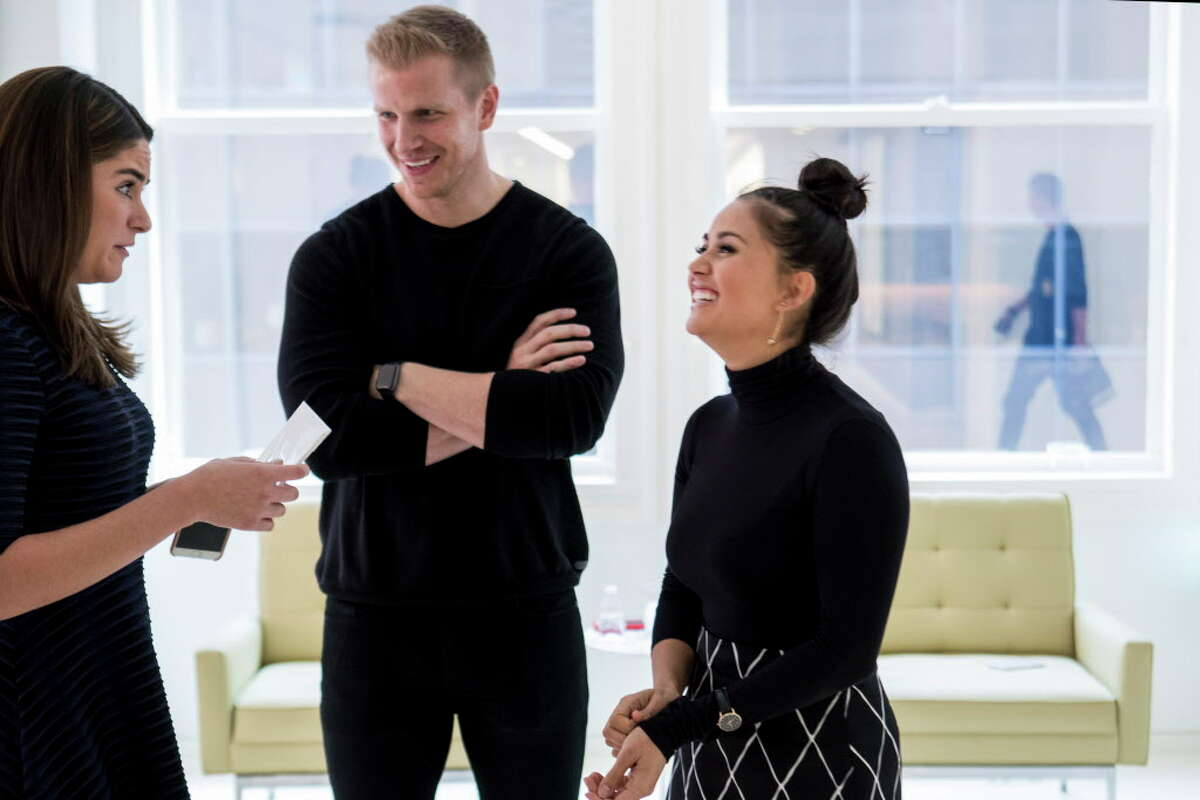 Mary Anne Cuellar, left, talks to Sean and Catherine Lowe during a taping of Billion Dollar Buyer at the offices of Dancie Perugini Ware Public Relations on Monday, Oct. 2, 2017, in Houston.
