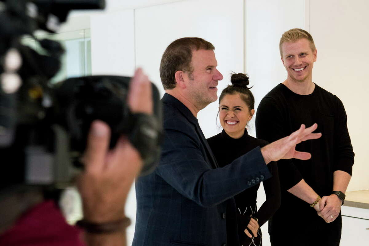 Tilman Fertitta, left, works with Catherine and Sean Lowe, during a taping of Billion Dollar Buyer at the offices of Dancie Perugini Ware Public Relations on Monday, Oct. 2, 2017, in Houston.