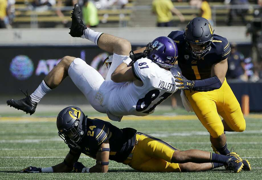 FILE - In this Sept. 9, 2017, file photo, Weber State tight end Andrew Vollert (87) is tackled after catching a pass between California cornerback Camryn Bynum (24) and linebacker Devante Downs (1) during the first half of an NCAA college football game in Berkeley, Calif. This week, California faces Southern California. California coach Justin Wilcox is a former USC defensive coordinator. (AP Photo/Jeff Chiu, File) Photo: Jeff Chiu, Associated Press