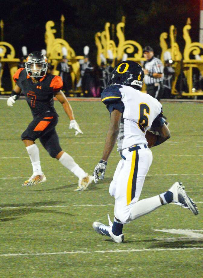 Edwardsville defensive back Rodney Smith, back, tracks the O'Fallon ball carrier during last Friday's game.