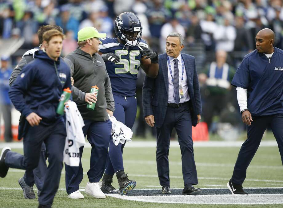 SEATTLE, WA - OCTOBER 1: Defensive end Cliff Avril #56 of the Seattle Seahawks walks off the field after being checked on by training staff in the first quarter of the game against the Indianapolis Colts at CenturyLink Field on October 1, 2017 in Seattle, Washington. (Photo by Otto Greule Jr/Getty Images) Photo: Otto Greule Jr/Getty Images
