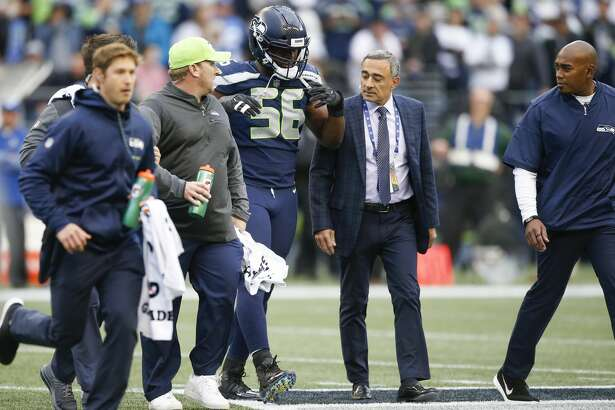 SEATTLE, WA - OCTOBER 1: Defensive end Cliff Avril #56 of the Seattle Seahawks walks off the field after being checked on by training staff in the first quarter of the game against the Indianapolis Colts at CenturyLink Field on October 1, 2017 in Seattle, Washington. (Photo by Otto Greule Jr/Getty Images)