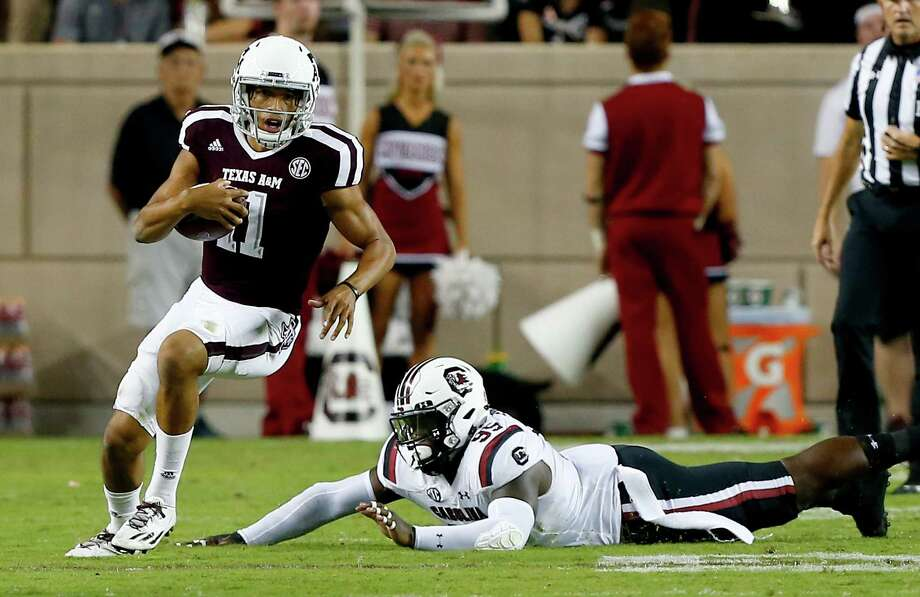 COLLEGE STATION, TX - SEPTEMBER 30:  Kellen Mond #11 of the Texas A&M Aggies avoids the tackle attempt of Dante Sawyer #95 of the South Carolina Gamecocks in the third quarter at Kyle Field on September 30, 2017 in College Station, Texas.  (Photo by Bob Levey/Getty Images) Photo: Bob Levey, Stringer / 2017 Getty Images