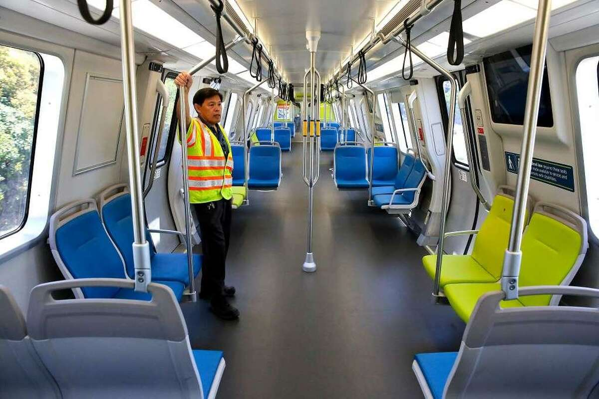 Vehicle engineer Rodney Lim rides the rails on one of BART's new train cars on a demonstration run at the South Hayward Station. The transportation agency plans to phase into service 775 new cars by 2022.