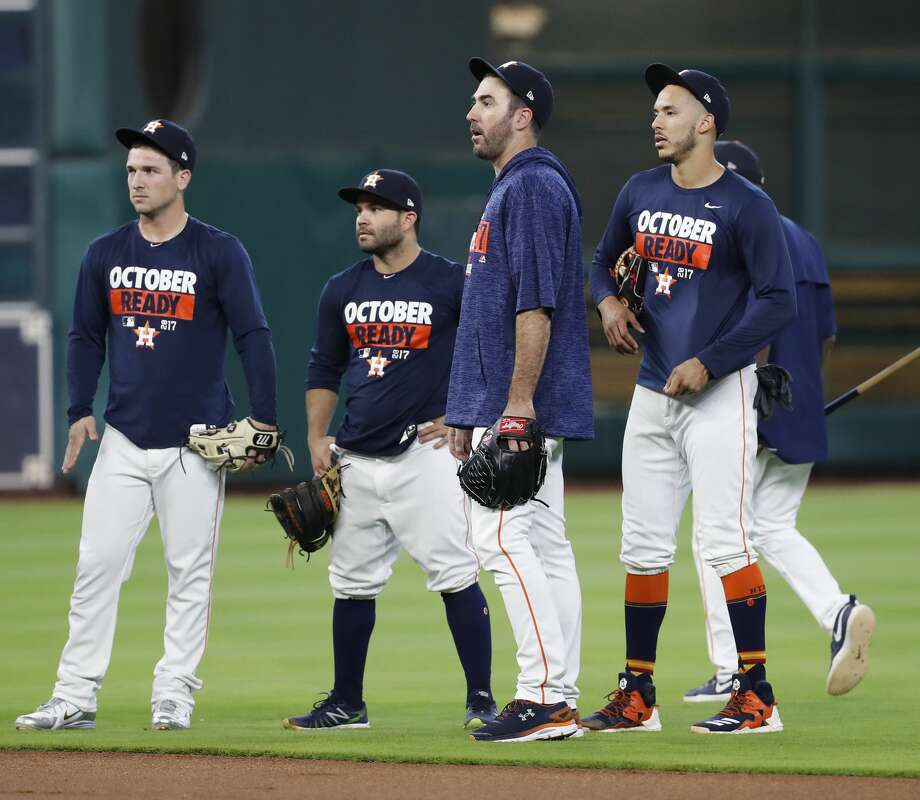 Houston Astros pitcher Justin Verlander chats with Carlos Correa, Jose Altuve, and Alex Bregman during batting practice at Minute Maid Park, Wednesday, Oct. 4, 2017, in Houston, as they prepare to take on the Boston Red Sox in the ALDS playoffs.   ( Karen Warren / Houston Chronicle ) Photo: Karen Warren/Houston Chronicle