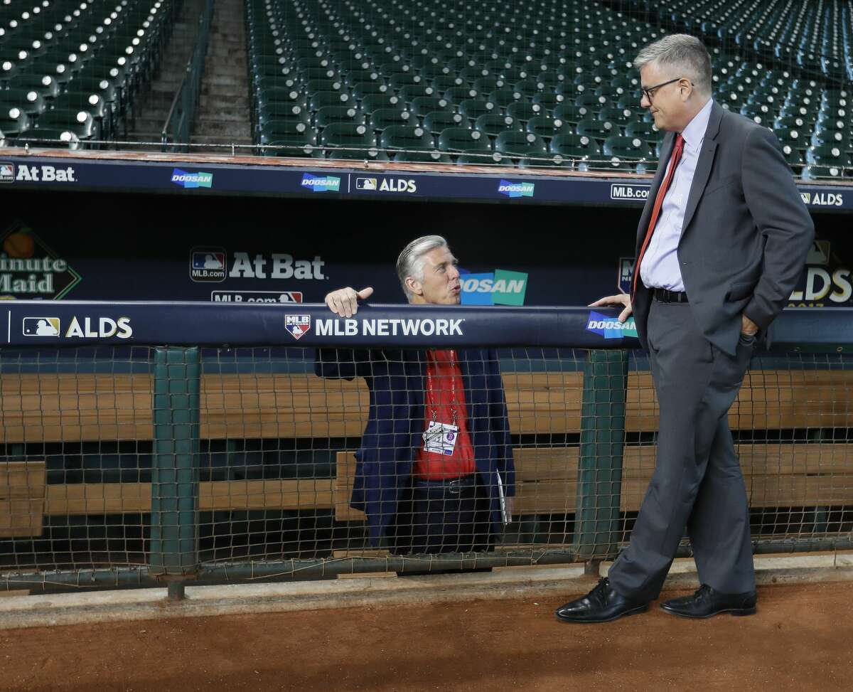 Houston Astros GM Jeff Luhnow chats wih Boston Red Sox GM Dave Dombrowski during the batting practice at Minute Maid Park, Wednesday, Oct. 4, 2017, in Houston, as they prepare to take on the Boston Red Sox in the ALDS playoffs. ( Karen Warren / Houston Chronicle )