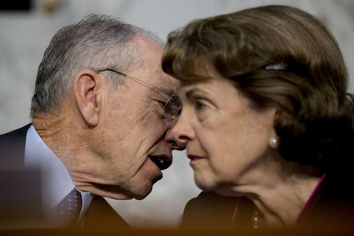 Chairman Sen. Chuck Grassley, R-Iowa, and Ranking Member Sen. Dianne Feinstein, D-Calif., right, speak together during a Senate Judiciary Committee hearing on Capitol Hill in Washington, Tuesday, Oct. 3, 2017, on the Trump Administration's decision to end Deferred Action for Childhood Arrivals otherwise known as DACA. (AP Photo/Andrew Harnik)