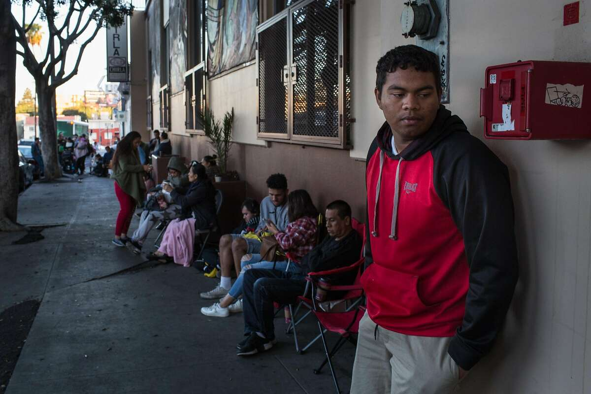 **EMBARGO: No electronic distribution, Web posting or street sales before 2:30 a.m. ET Monday, Oct. 2, 2017. No exceptions for any reasons. EMBARGO set by source.** Brian Solis, a Deferred Action for Childhood Arrivals recipient from Mexico, waits in line at the Coalition for Human Immigrant Rights of Los Angeles, Sept. 26, 2017. Around the country, thousands of young undocumented immigrants have been lining up at legal clinics and scrambling to renew their protections before the clock runs out on their chance to live and work legally in the United States. (Christopher Lee/The New York Times)