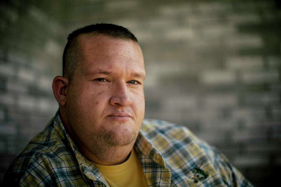 In this Aug. 22, 2017 photo, Brandon Spurgin sits at home of his mother Reese in Velma, Okla. Spurgin was struggling with a meth addiction when the Stephens County drug court sent him to Christian Alcoholics & Addicts in Recovery, also known as CAAIR, in 2014. Judges across the country are ordering defendants into recovery centers that are little more than work camps for private industry, an investigation by Reveal from The Center for Investigative Reporting has found. Even after being injured while working at the chicken plant, Spurgin kept working. If he didn't, CAAIR could kick him out, and he would be sentenced to 15 years in prison. (Shane Bevel/Reveal via AP) Photo: Shane Bevel, HONS / AN AUG 22, 2017 PHOTO