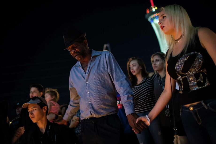LAS VEGAS, NV - OCTOBER 2: Mourners attend a candlelight vigil at the corner of Sahara Avenue and Las Vegas Boulevard  for the victims of Sunday night's mass shooting, October 2, 2017 in Las Vegas, Nevada. Late Sunday night, a lone gunman killed more than 50 people and injured more than 500 people after he opened fire on a large crowd at the Route 91 Harvest Festival, a three-day country music festival. The massacre is one of the deadliest mass shooting events in U.S. history. (Photo by Drew Angerer/Getty Images) Photo: Drew Angerer, Staff / Getty Images