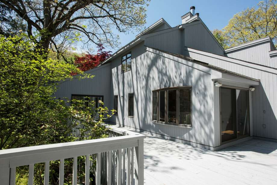 The gray contemporary house at 13A Dogwood Lane in Westport sits on a 1.55-acre property in a private setting yet close to town and train. Photo: Contributed Photos