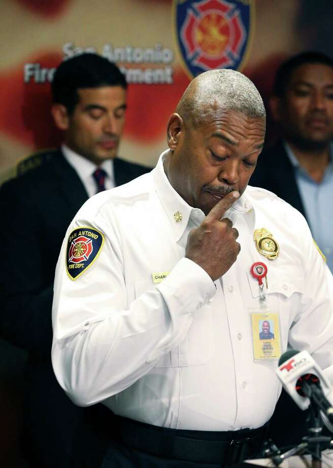 Fire Chief Charles Hood fights back tears as he answers questions after officials announce the arrest on October 4, 2017 of an arsonist in the Ingram Square Shopping Center fire which killed firefighter Scott Deem and severly injured firefighter Brad Phipps. Photo: Tom Reel, San Antonio Express-News / 2017 SAN ANTONIO EXPRESS-NEWS