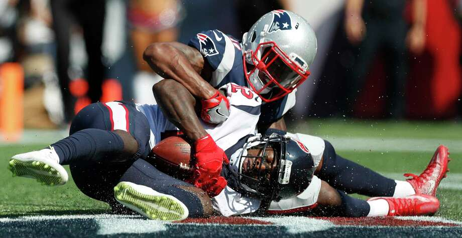 Houston Texans wide receiver Bruce Ellington (12) comes down with a 29-yard touchdown reception against New England Patriots cornerback Jonathan Jones (31) during the first quarter of an NFL football game at Gillette Stadium on Sunday, Sept. 24, 2017, in Foxbourough, Mass. ( Brett Coomer / Houston Chronicle ) Photo: Brett Coomer, Staff / © 2017 Houston Chronicle