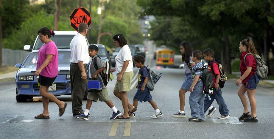 Representatives of Safe Kids San Antonio and the city initiative Vision Zero, which works to increase vehicle and pedestrian safety on the roadways, visited 18 campuses across various school districts on Wednesday to teach students how to walk to school safely. Photo: San Antonio Express-News File Photo / SAN ANTONIO EXPRESS-NEWS