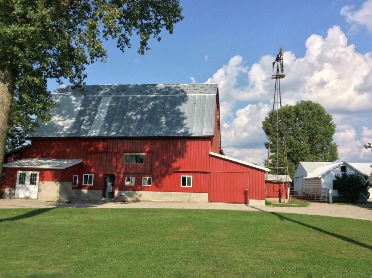 Red barns dot the scenic countryside in Amish Country.
