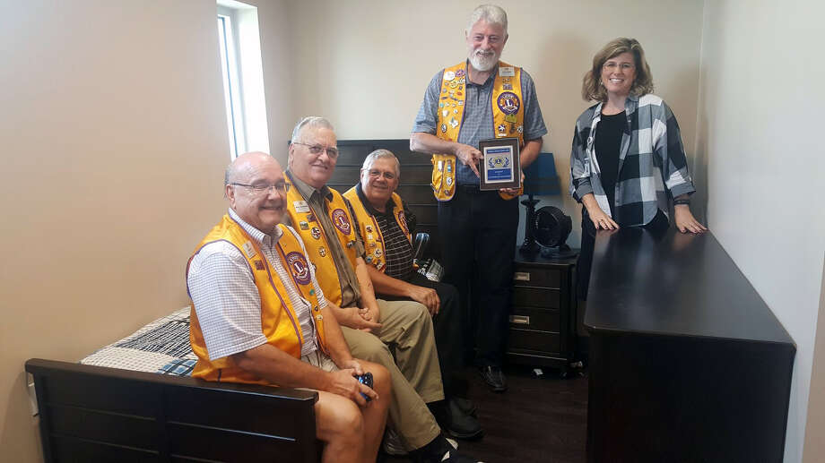 The Humble Noon Lions Club and Including Kids executive director, Jennifer Dantzler, pose for a photo in the InKids facility's new bedroom area during a facility tour on Thursday, Sept. 28 in Atascocita. From left to right:Gary Fritz, Joe Bocklage, Tony Austin, Neil Lander, Jennifer Dantzler. Photo: Melanie Feuk