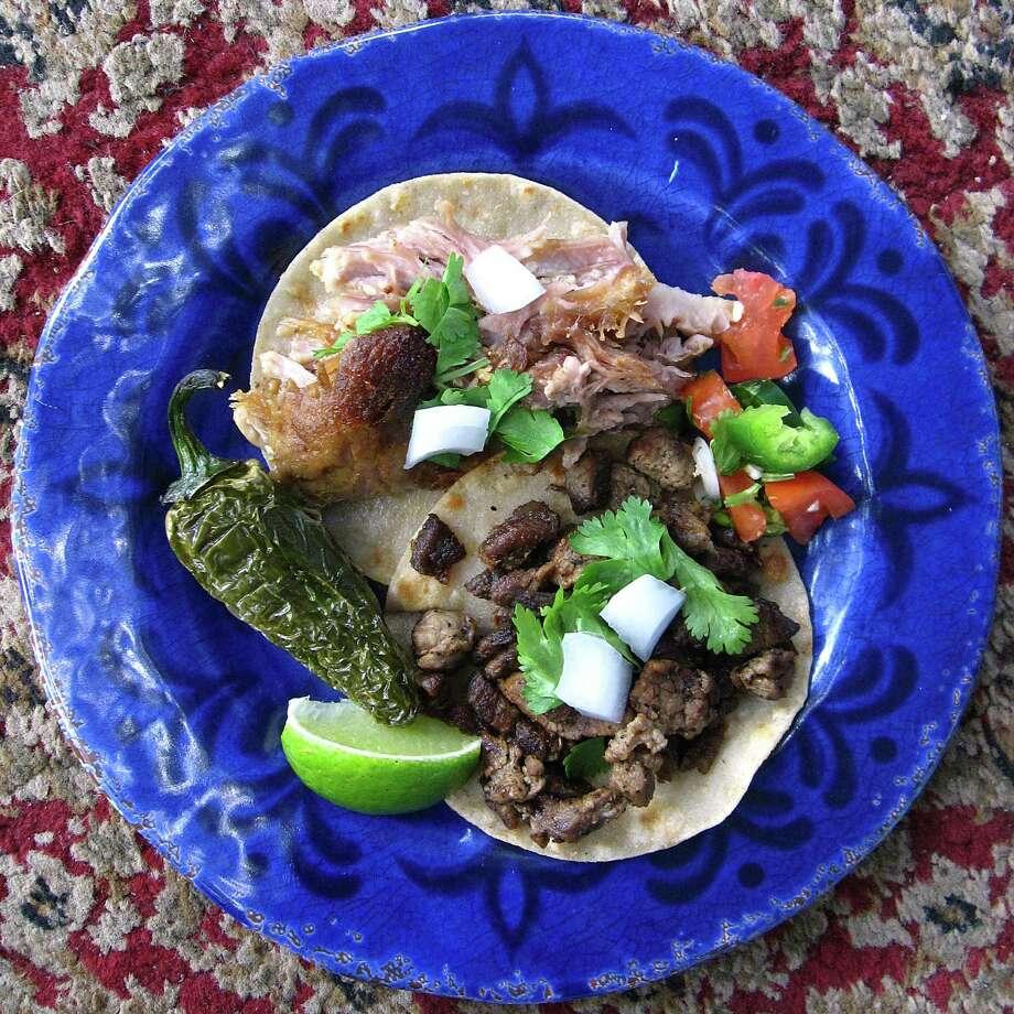 Carnitas and carne asada mini-tacos on corn tortillas from Casa Azul de Andrea. Photo: Mike Sutter /San Antonio Express-News