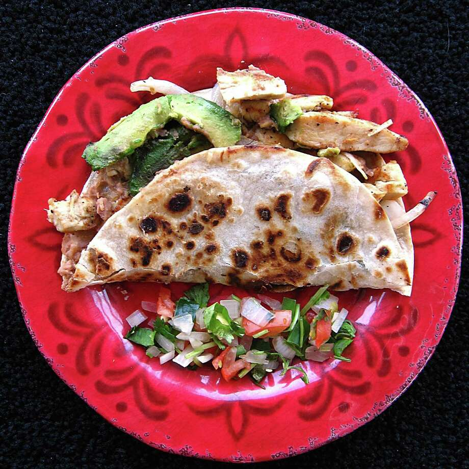 Chicken fajita norteño taco with cheese on a toasted flour tortilla from L Taco. Photo: Mike Sutter /San Antonio Express-News