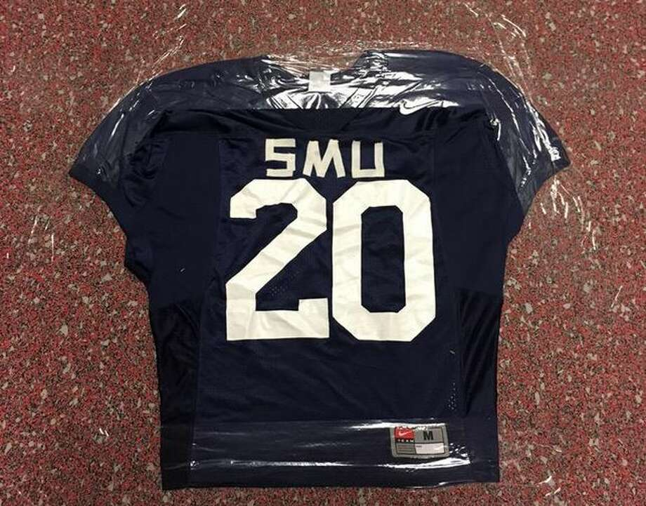 An SMU jersey taped to the floor of the UH football locker room by former coach Tom Herman's staff.