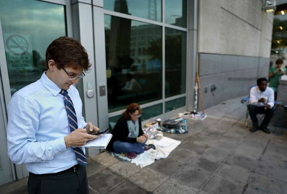 Elad Gross, a constitutional lawyer, works on his phone outside the St. Louis jail on Wednesday, Oct. 4, 2017, as he waits to be let in to speak with some of the people who were arrested for blocking Interstate 64 on Tuesday night as part of the ongoing demonstrations against the acquittal of a white former police officer in the 2011 killing of a black man. (David Carson/St. Louis Post-Dispatch via AP) Photo: David Carson, MBI / St. Louis Post-Dispatch