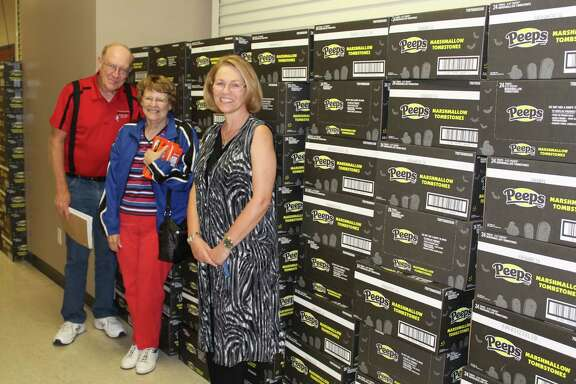 Unity Committee members Jim and Glenda Plumlee, and Frieda Joyce stand next to the 502 cases of Halloween-theme Peeps that were donated to Treat Street by Cornerstone Church and Heaven's Army. The Peeps will be handed out during the Oct. 31 event at the Cleveland Civic Center.