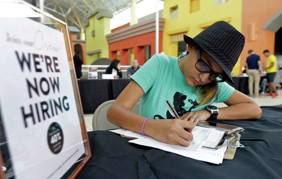 Job seeker Alejandra Bastidas fills out an application at a job fair, Tuesday, Oct. 3, 2017, at Dolphin Mall in Sweetwater, Fla. On Wednesday, Oct. 4, 2017, payroll processor ADP reports how many jobs private employers added in September. (AP Photo/Alan Diaz) Photo: Alan Diaz, STF / Copyright 2017 The Associated Press. All rights reserved.