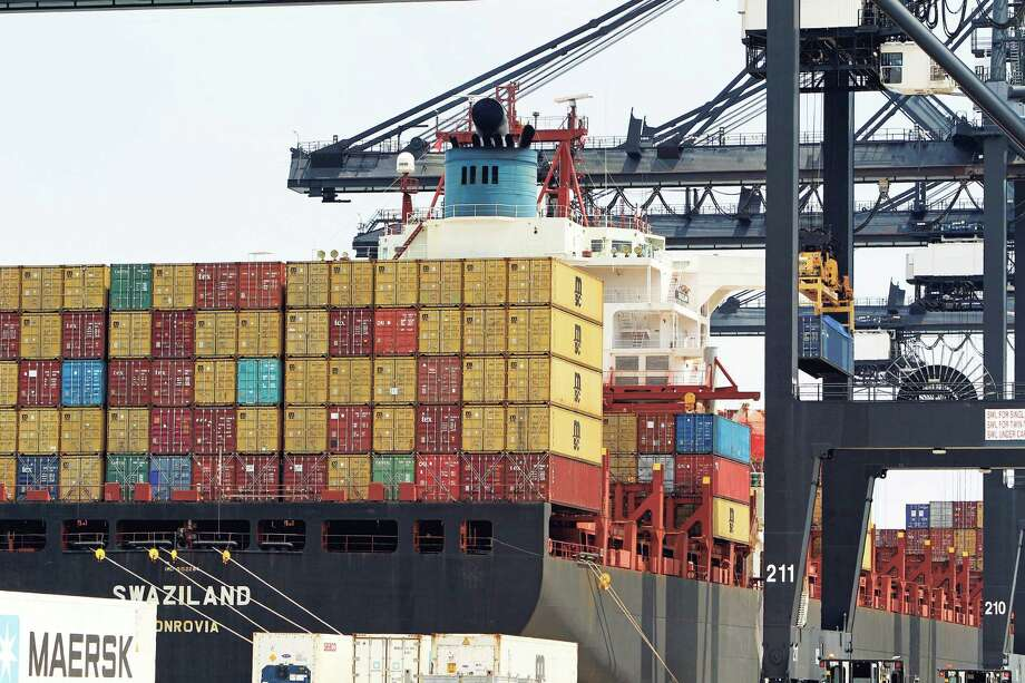 A container ship at a Port of Houston Authority dock is seen, Aug. 13, 2015. The stakes and opportunities to trade with TPP-member countries are massive. According to the U.S. trade office, American companies — big and small — exported more than $622 billion in goods to TPP-member countries in 2013. The TPP provides the opportunity to massively expand this trade. ( Steve Gonzales / Houston Chronicle ) Photo: Steve Gonzales, Staff / © 2015 Houston Chronicle
