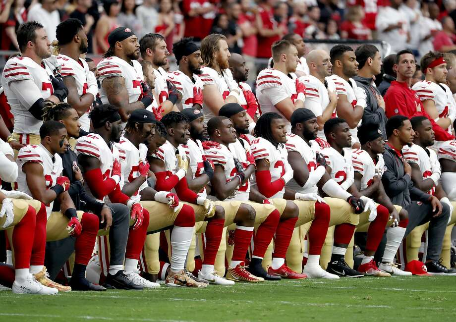 Members of the San Francisco 49ers kneel during the national anthem as others stand during the first half of an NFL football game against the Arizona Cardinals, Sunday, Oct. 1, 2017, in Glendale, Ariz. (AP Photo/Rick Scuteri) Photo: Rick Scuteri, Associated Press