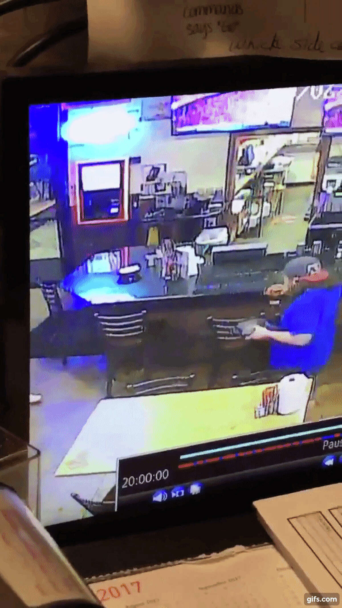 A viral video captured at a Bayou City Wings in Baytown shows a woman trying to knock some takeout food from a man's hand and failing miserably.