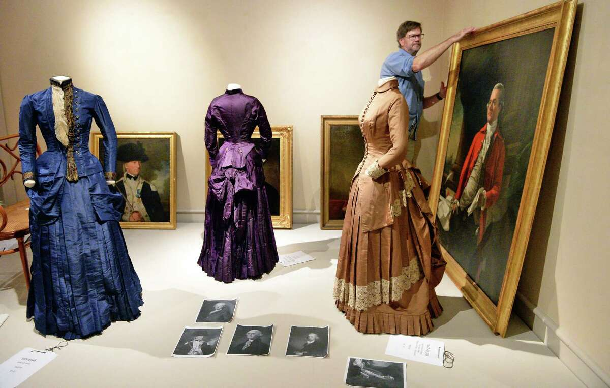 """Exhibit designer Tom Nelson prepares a Victorian gallery scene at Albany Institute of History & Art's new exhibit on """"Well-Dressed Victorian Albany,"""" Wednesday Oct. 4, 2017 in Albany, NY. (John Carl D'Annibale / Times Union)"""