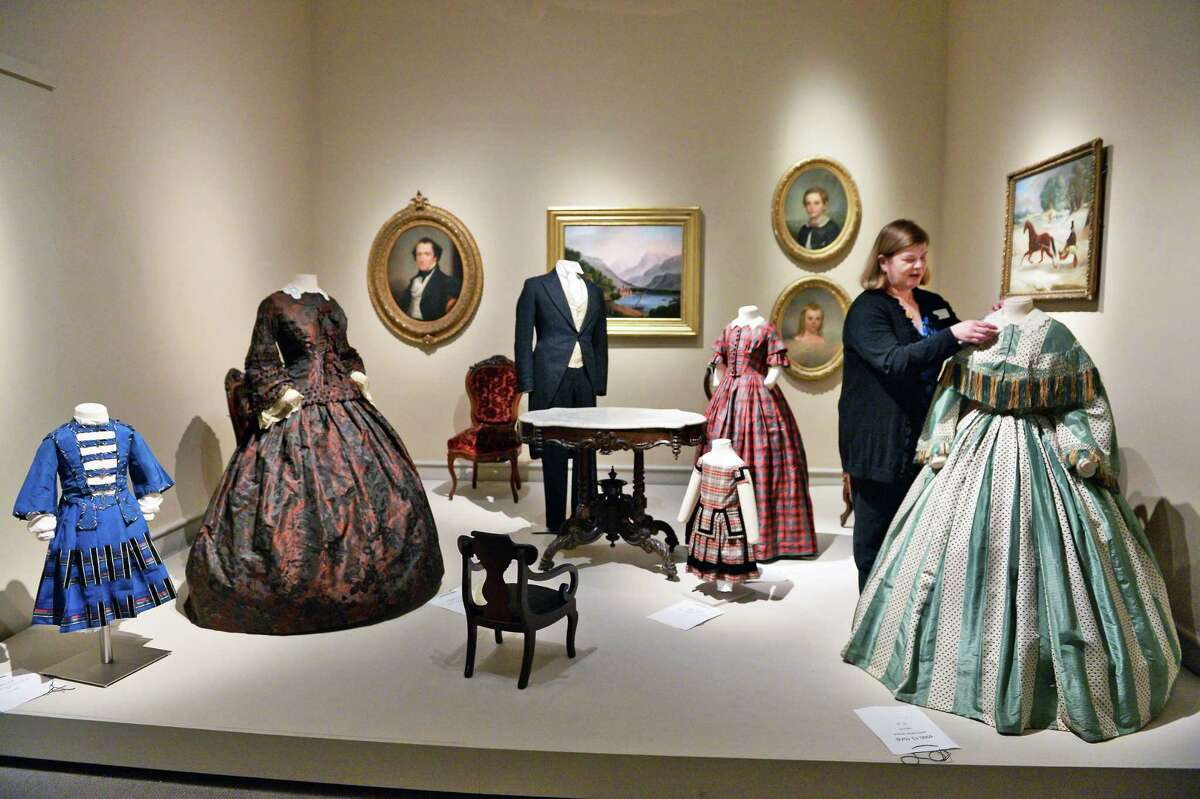 """Curator Diane Shewchuk puts a finishing touch to an 1850's parlor installation at Albany Institute of History & Art's new exhibit on """"Well-Dressed Victorian Albany,"""" Wednesday Oct. 4, 2017 in Albany, NY. (John Carl D'Annibale / Times Union)"""
