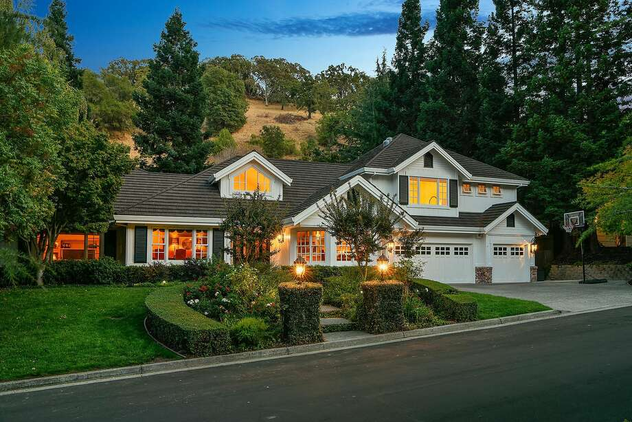 Manicured hedges and rose bushes lend curb appeal to the Lafayette home. Photo: Open Homes Photography