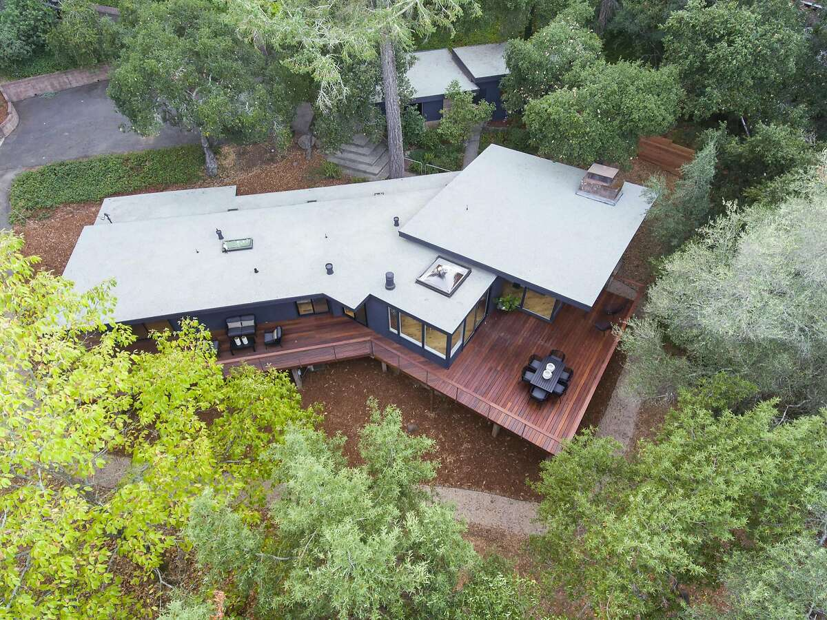 This aerial photograph showcases the wraparound deck off the back of the home.
