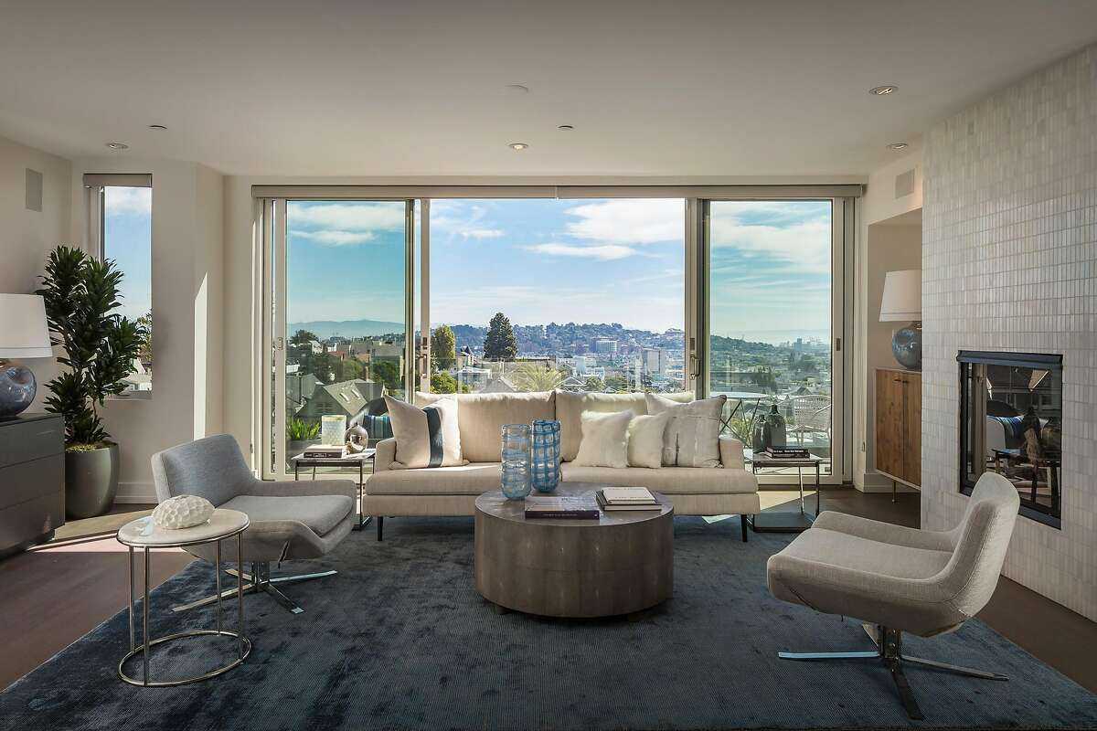 Sliding glass doors off the great room open to a deck overlooking the Dolores Heights neighborhood.