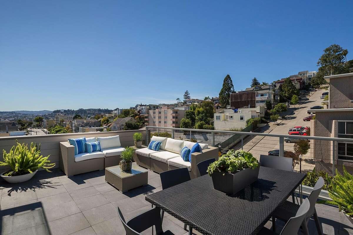 The patio off the great room looks toward the San Francisco skyline.