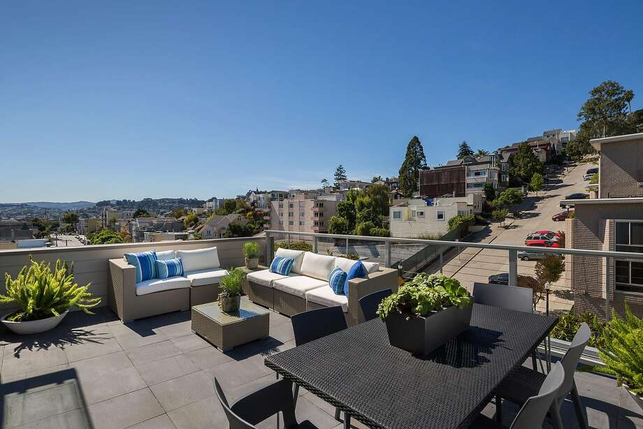 The patio off the great room looks toward the San Francisco skyline. Photo: Jacob Elliott Photography