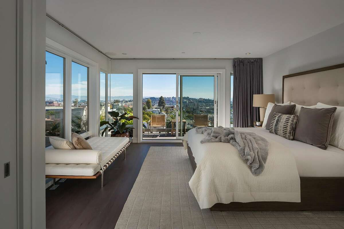 Corner windows in the master bedroom look out at downtown San Francisco.