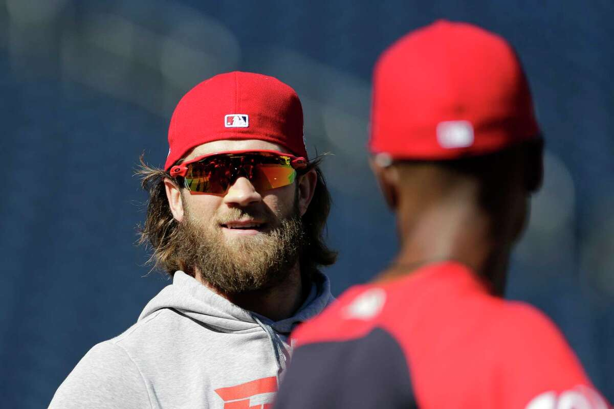 Washington Nationals' Bryce Harper warms up prior to baseball practice at Nationals Park, Wednesday, Oct. 4, 2017, in Washington. Game 1 of the National League Division Series against the Chicago Cubs is Friday. (AP Photo/Mark Tenally) ORG XMIT: NAT101