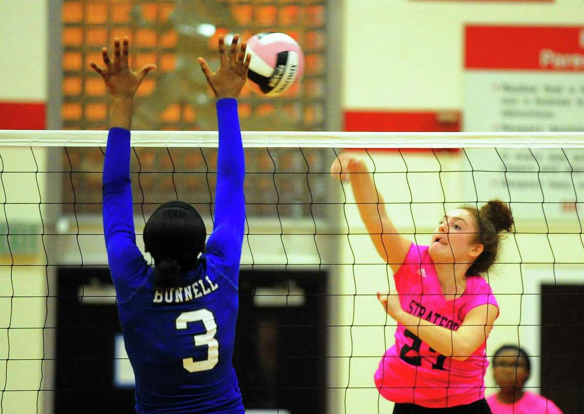Stratford's Gillian Mariconda spikes the ball as Bunnell's Kayla Sokunle tries to block during girls volleyball action in Stratford, Conn. on Wednesday, Oct. 4, 2017.