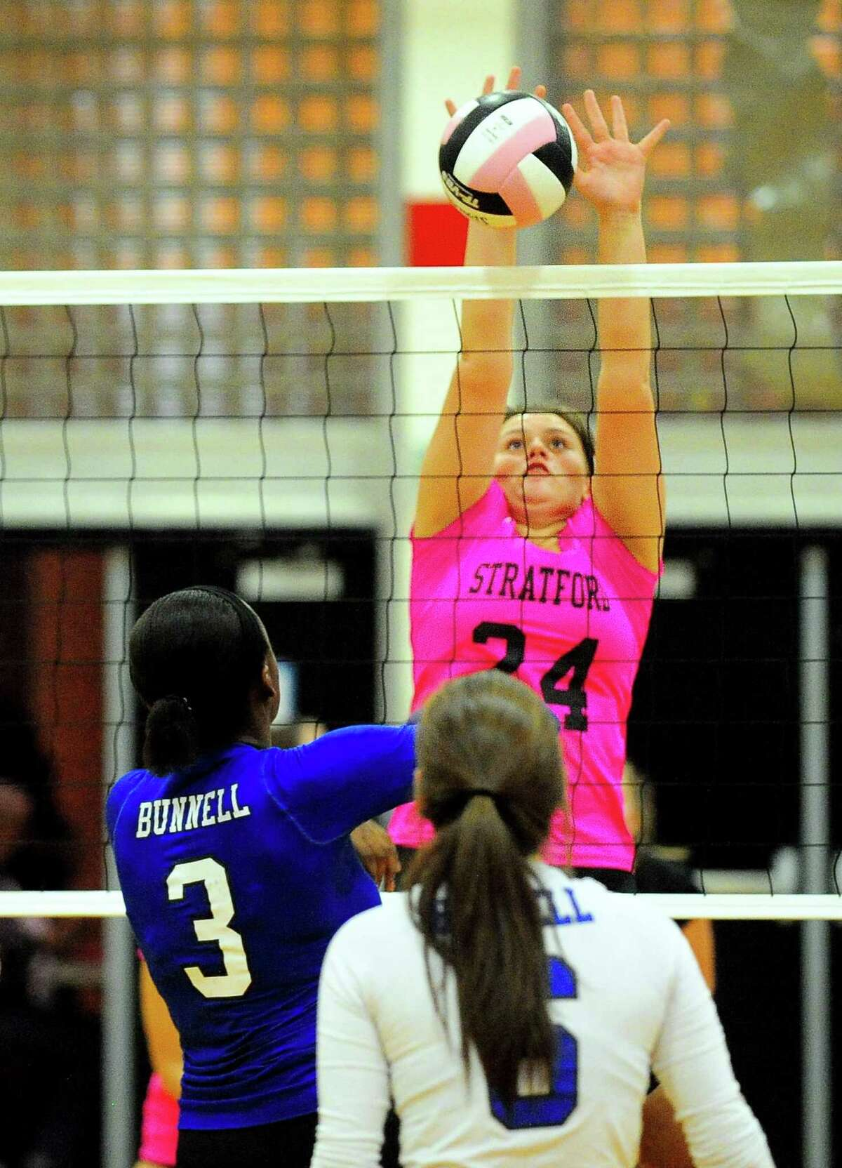 Stratford's Samantha Carbone blocks a spike by Bunnell's Kayla Sokunle during girls volleyball action in Stratford, Conn. on Wednesday, Oct. 4, 2017.