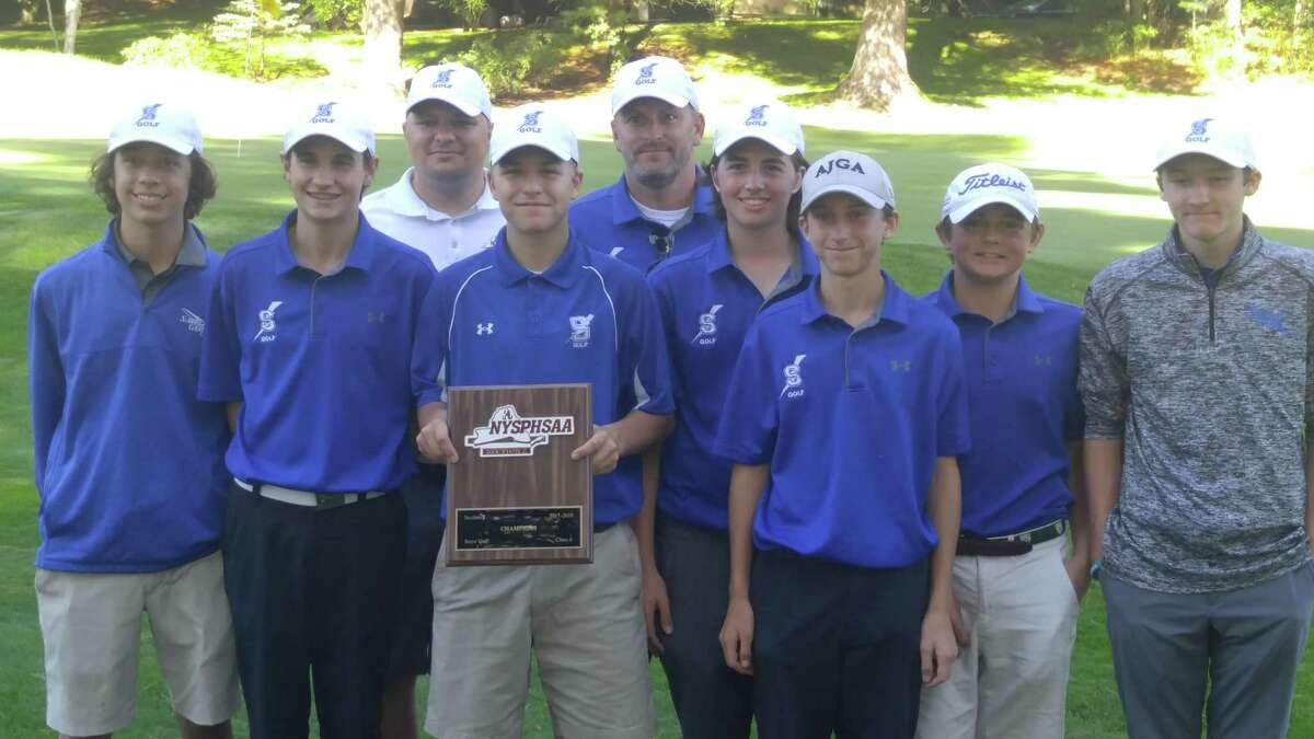 Members of the Saratoga Springs boys' golf team, winners Wednesday, Oct. 4, 2017, of the Section II Class A golf championship at McGregor Links. From left: Brendan Joyce, A.J. Cavotta, Ethan Mania, Dylan Finnegan, Will Braxton, Clarkie Carroll and Nolan Crowley. In the back are assistant coach Steve Emler and head coach Mike Hall. (Pete Dougherty/Times Union)