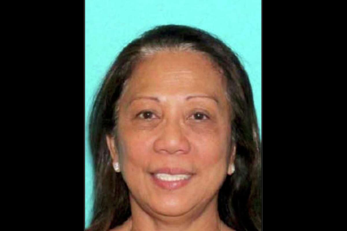 This undated photo provided by the Las Vegas Metropolitan Police Department shows Marilou Danley. Danley, 62, returned to the United States from the Philippines on Tuesday night, Oct. 3, 2017, and was met at Los Angeles International Airport by FBI agents, according to a law enforcement official. Authorities are trying to determine why Stephen Paddock, Danley's boyfriend, killed dozens of people in Las Vegas Oct. 1, in the deadliest mass shooting in modern U.S. history. (Las Vegas Metropolitan Police Department via AP, File) ORG XMIT: BKWS105