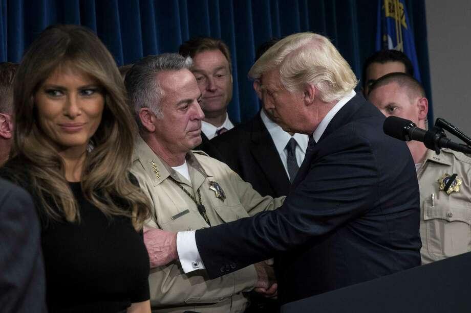 President Donald Trump, with wife Melania, embraces Sheriff Joe Lombardo on Wednesday. Photo: Drew Angerer, Staff / 2017 Getty Images