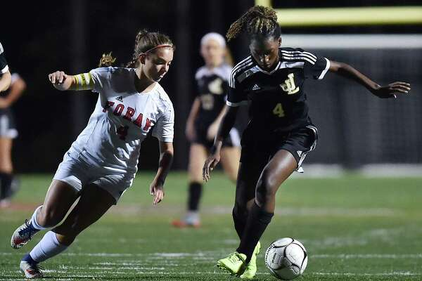 Law senior Rhea Grant controls the ball as Foran senior captain Mikayla Duhaime defends Wednesday at the DeVito Field at Foran High School in Milford. Law won 4-0 to remain unbeaten.