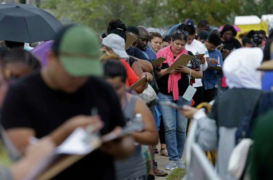 People fill out applications for the state's Disaster Supplemental Nutrition Assistance Program. Photo: Melissa Phillip, Houston Chronicle / © 2017 Houston Chronicle