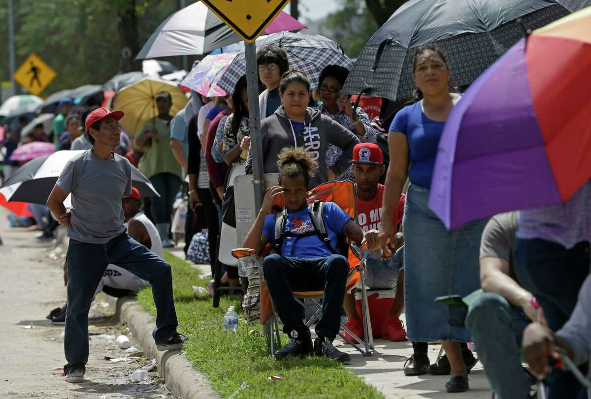 Thousands of people waited in long lines Wednesday to apply for the state's Disaster Supplemental Nutrition Assistance Program down the street from the Southwest Multi-Service Center in Houston.