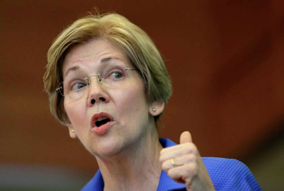 """FILE - In this March 27, 2017, file photo, Sen. ElizabethWarren, D-Mass., addresses business leaders during a New England Council luncheon in Boston. Warren warned Friday, June 16, that President Donald Trump and his Republican allies are preparing to deliver """"a knockout blow"""" to the nation's middle-class. The liberal icon delivered the comments to a packed theater in the heart of Manhattan's Times Square. It was the final scheduled stop in a book tour that featured a half-dozen appearances nationwide over the last two months. (AP Photo/Steven Senne, File) Photo: Steven Senne, STF / Copyright 2017 The Associated Press. All rights reserved."""