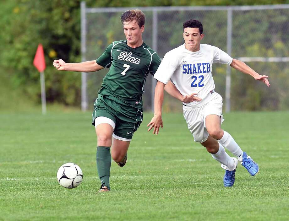 Shenendehowa's Eric Makhatadze (7) and Shaker's Demani Johnson (22) chase a loose ball during a Section II Class AA boys' high school soccer game in Latham, N.Y., Thursday, Sept. 7, 2016. (Hans Pennink / Special to the Times Union) ORG XMIT: HP108 Photo: Hans Pennink / Hans Pennink